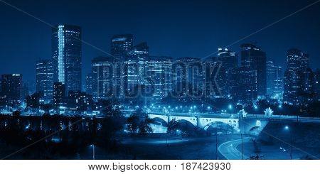 Calgary downtown cityscape with skyscraper and bridge at night, Canada.