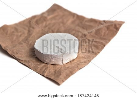 Fresh Camembert cheese is a natural, on Kraft paper brown background. With clipping path