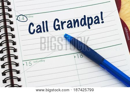 Reminder to call your grandfather A calendar with a pen and text Call Grandpa