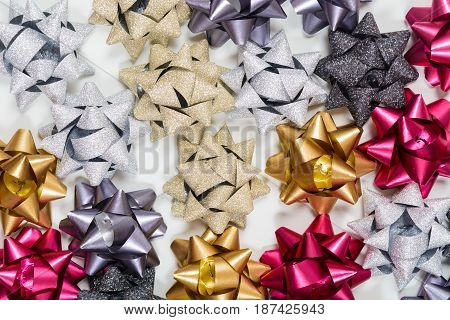 Background Of Festive Bows On White