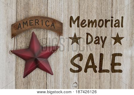 Memorial Day sale message USA patriotic old star on a weathered wood background with text Memorial Day Sale