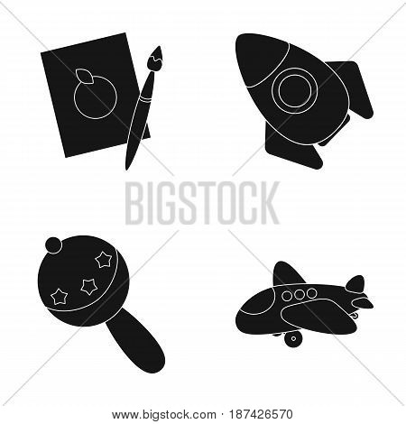 A sheet of paper with an apple pattern, a paint brush, a flying rocket with a porthole, a rattle for a child, an airplane with a chassis and a porthole. Toys set collection icons in black style vector symbol stock illustration