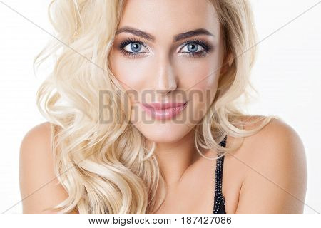 Portrait of beautiful blonde girl with healthy perfect skin, big blue eyes, long eyelashes. Natural look