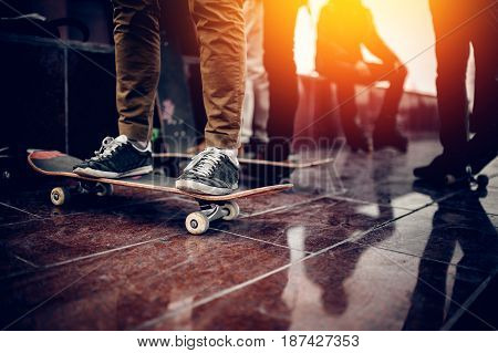 Skaters friends team outdoor in urban city with skateboards in their hands. Young people training longboard extreme sport. concept friendship. Warm filter