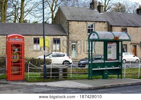 WADDINGTON, UK - FEBRUARY 4, 2017: A emergency defibrillator being used in a old style UK red phone box in the small village of Waddington, Lancashire, UK
