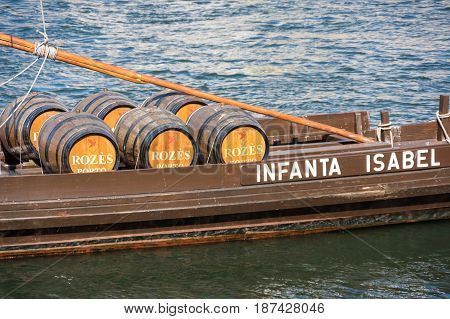 PORTO PORTUGAL - OCTOBER 21 2015: Typical wine boat in the Douro river in the historical center of Porto the second largest city in Portugal after Lisbon