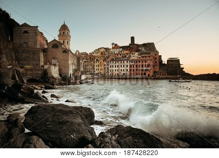 Vernazza with buildings on rocks over sea in Cinque Terre, Italy.
