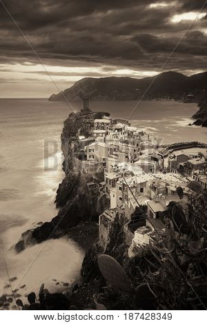 Vernazza with buildings on rocks over sea black and white in Cinque Terre, Italy.