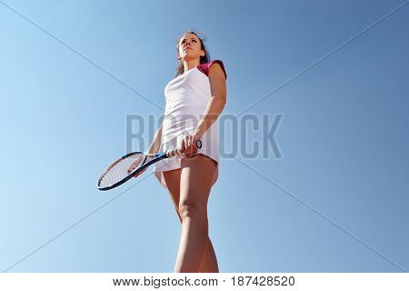 woman tennis player with racket during a match game isolated