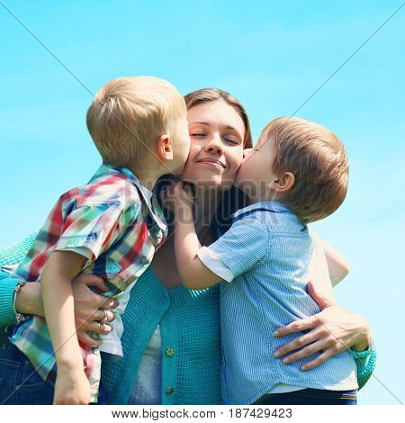 Moment Of Happy Mother! Portrait Family Two Children Sons Kissing Mom, Mother's Day, Over Blue Sky B