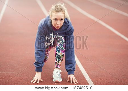 Young Girl Preparing To Run The Sports Track