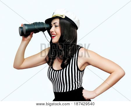 Travel cruise people concept - pretty smiling woman brunette sailor looking through binoculars pin-up style over white background