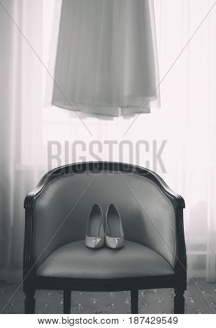 Wedding Photo Room Of The Bride, Shoes Heels On The Chair And Dress