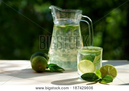 Aloe vera in a jar and glass cup with mint