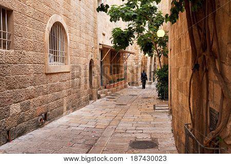 Man siluette walking on empty istreet n old town of Jerusalem. Jerusalem Old City. Israel