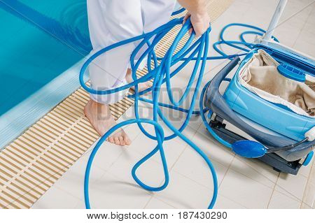 Pool Cleaning and Sanitation Concept Closeup Photo. Swimming Pool Cleaning Equipment.
