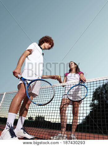 tennis players give the ball fair play concept