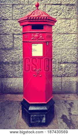 Traditional red post box in London, United Kingdom