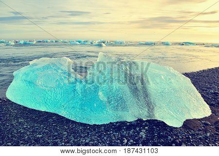 Iceberg at crystal black beach in south Iceland Jokulsarlon Glacial Lagoon