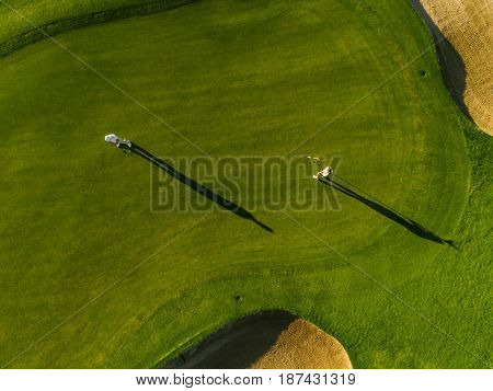 Aerial View Of Golfers Playing On Course