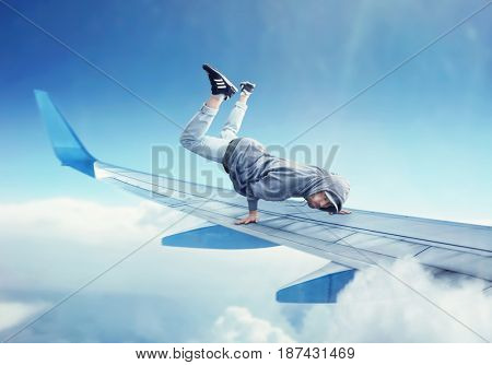 Dance performer, dancing exercise on plane wing