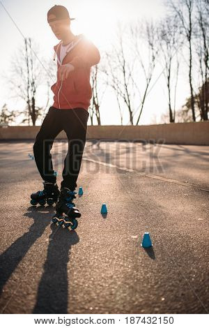 Roller skater rides the snake, rollerskating trick