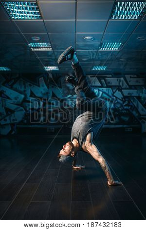 Hip hop motions, male performer in dance studio