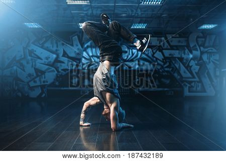 Breakdance motions, performer in dance studio