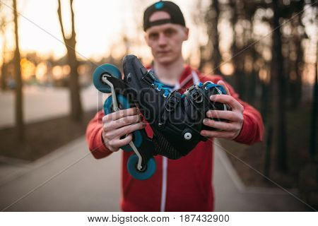 Male person shows roller skates
