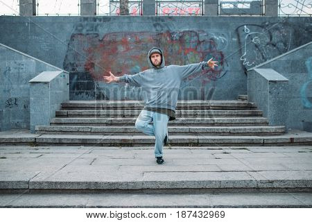 Rap performer posing on the steps, street dancing