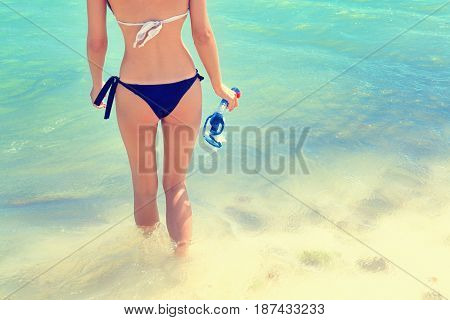 Young woman at the beach with snorkeling gear