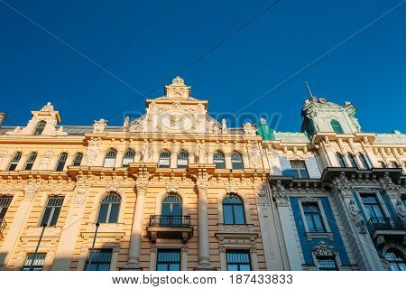 Riga, Latvia. Facade Of Old Art Nouveau Building Designed By Mikhail Eisenstein On 13 Alberta Street, Currently Houses The Graduate School Of Law. Sunny Summer Day Under Blue Clear Sky.