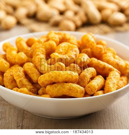 Hearty peanut puffs in a small bowl