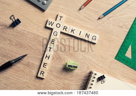 Crossword of wooden blocks presenting concept of union and collaboration