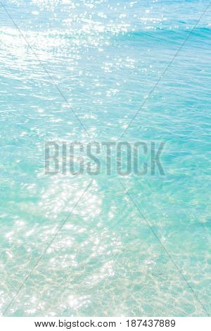 Glare on the blue clear sea water
