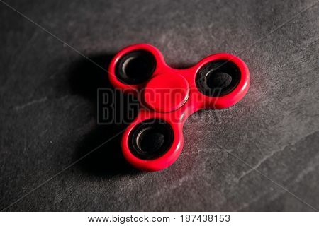 Red spinner Fidget finger stress anxiety relief toy.