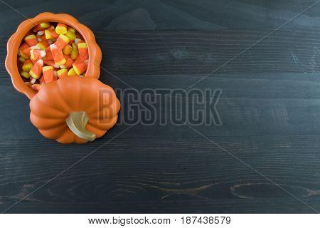 Candy Corn in Ceramic Pumpkin on Dark Background