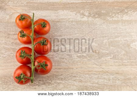 Tomatoes On A White Wooden Background Close Up Copy Space.