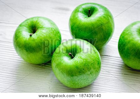 summer food with green apples on white table background