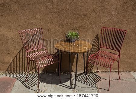 small cute table and chairs on a sunny patio