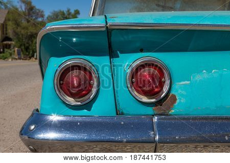 Old classic teal car tail lights from behind