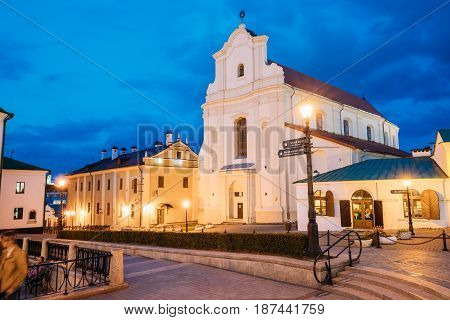 Minsk, Belarus - September 2, 2016: Illuminated Monastery Of The Holy Spirit Bazilianok. Nemiga Historic District In Old Part Of Minsk. Famous Landmark At Evening Or Night Street Lights