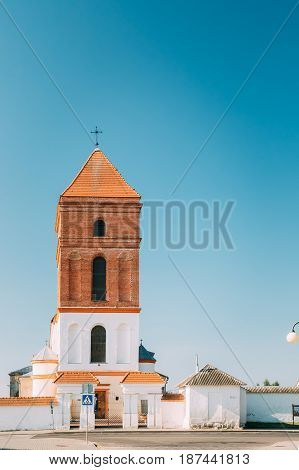Mir, Belarus. Saint Nicolas Roman Catholic Church In Mir, Belarus. Famous Landmark In Sunny Summer Day With Blue Sky