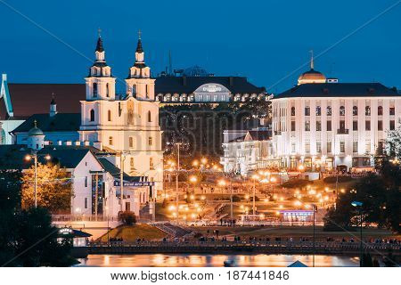 Minsk, Belarus - September 3, 2016: Famous Landmark At Summer Evening Or In  Night Lights Illumination.  Cathedral Of Holy Spirit At Blue Hour. View From City River's Embankment.