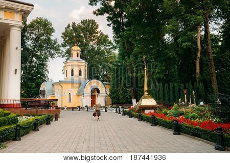 Gomel, Belarus. Woman Visiting Church Near Peter And Paul Cathedral In City Park At Summer Evening In Gomel, Belarus.