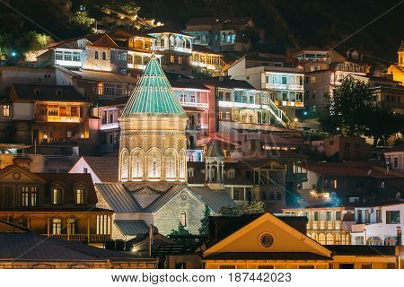 Tbilisi, Georgia. Saint George Armenian Cathedral Of Tbilisi. Church In Evening Or Night Illumination. Famous Landmark