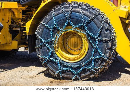Large Bulldozer With Snow Chains On Tires