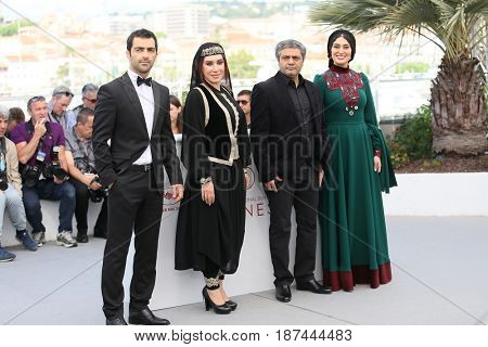 Soudabeh Beizaee, Mohammad Akhlaghirad and Nasim Adabi attend 'Lerd (Un Homme Integre)' Photocall during the 70th Cannes Film Festival at Palais des Festivals on May 19, 2017 in Cannes, France.