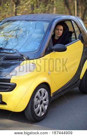 MOSCOW - OCT 25, 2016: Woman (with model release) sits in Mercedes Smart in Sokolniki where conducted Auto Show - Oldtimer, Gallery