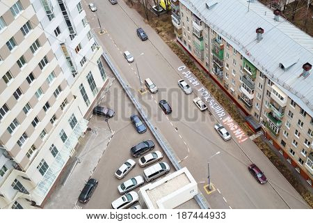 MOSCOW - APR 14, 2016: (top view) Cars near buildings in Elk island residential complex, text translation - happy birthday to Masik, Elk island was built by Donstroy Company, established in 1994